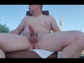 Jacking off outside facing Highway