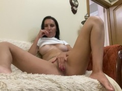 Brunette with big tits masturbates with a lollipop