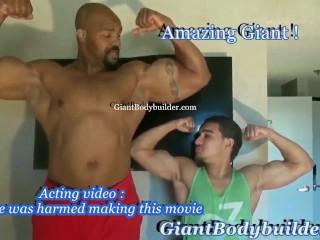 Tall giant black bodybuilder posing next to average...