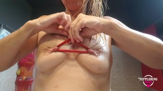 nippleringlover inserting long balloon through pierced nipples - pierced tits - stretched nipples 1