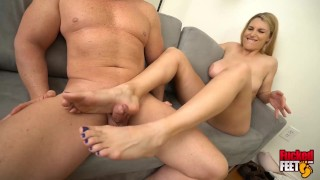 Screen Capture of Video Titled: Hot Sexy Blonde Joslyn Jane Gives Nut Busting First Footjob!