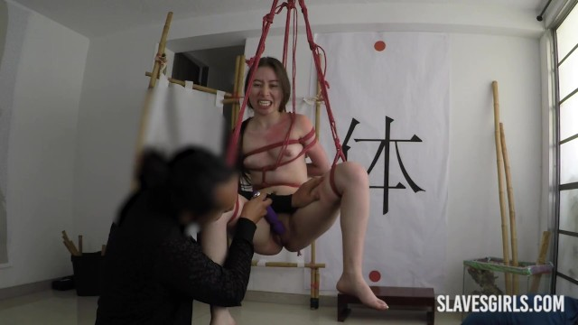 Asian girl submissive in the ropes with vibrator machine