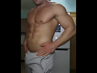 Bodybuilder showing off his muscles and then getting fucked by a huge ebony dildo close up