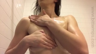 Tattooed amateur rubs oil all over small tits