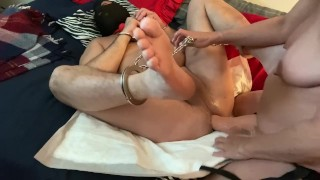 Mistress pegging sub while feet and hands are shackled together