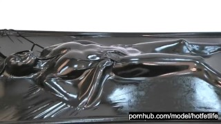 Wonderful hot rubber girl in full encased in black latex catsuit enjoys her vacuum bed vacbed