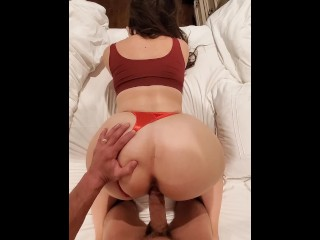 In a sexy red thong...
