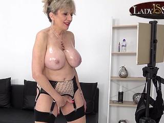 Oils up her tits then masturbates...