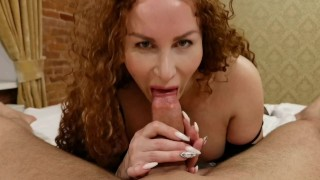 Red-haired beauty sucks a big dick and squirts