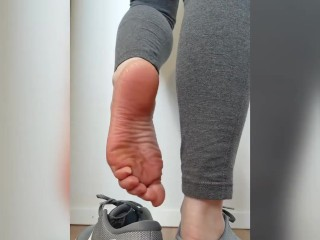 Taking off and playing with my sneakers with my sweaty, warm, bare feet