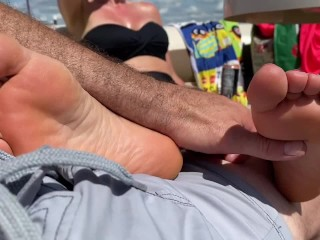 Public foot rub boat beached on shore...