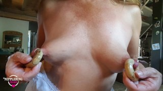 nippleringlover flashing pierced tits with monster nipple rings while working in kitchen at home
