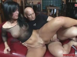 Hot slut hair wears her fishnet top while...