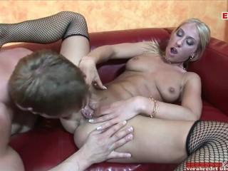 Hot skinny blonde in black fishnet stockings and...
