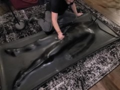 Twink Rubber Pup in latex Vacbed