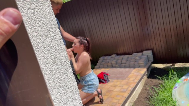 Caught in front of a security camera. Busty girl sucks boyfriend in my backyard!