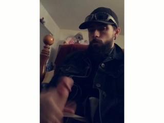 Bearded biker jacks off moans and cums