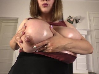 Samanta Lily is caressing her giant tits on cam