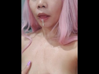 Pink hair drools on her small tits...