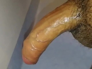 Oily uncircumcised tiny penis gets a quickie jerkoff into a slow motion wall shot cum splurge!