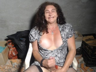 MATURE Busty Hung British Tranny Big spunk in the woodshed
