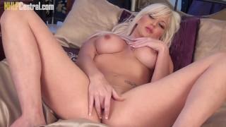 Beautiful busty blonde Jennifer Jade slips panties off and wanks hard to orgasm