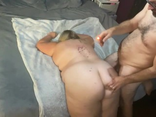 Dripping bdsm candle wax on milfs back while...