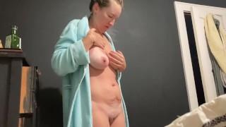 Busty MILF nurse lotions big sunburned saggy tits, puts on her scrubs