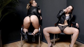 A bitch in each jacket plays with her pussy at the workplace