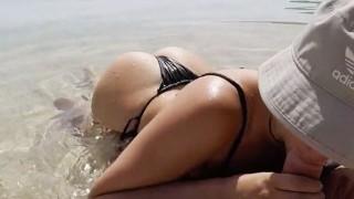 Hot couple having sex on public beach