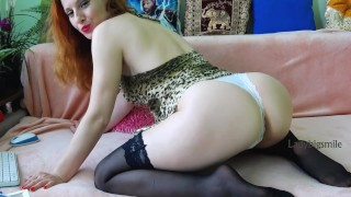 Beautiful redhead woman show ass in slim panties and sexy feet in black stockings