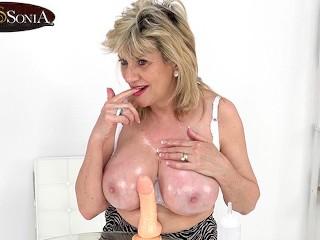 Your busty stepmom helps you wank...