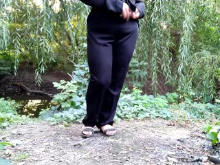 Russian milf pissing outdoors...