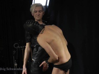 Two guys in leather teach a slave to...