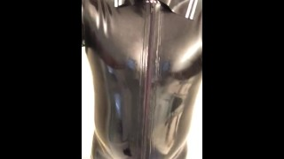 Tight latex catsuit with cock and ball ring